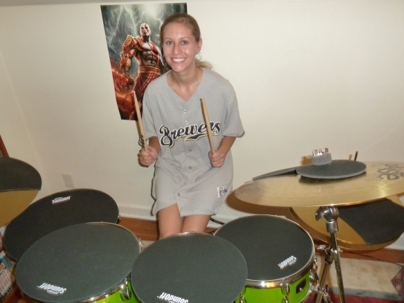 As you can see, I'm super excited about my new drum set! I'm sporting my XL Brewers jersey here. It looks like a dress, but I am wearing shorts. :P